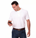 Charming young male using his cellphone portrait of a on white t shirt and jeans while standing on isolated background Stock Photography