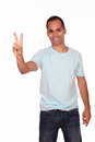 Charming young man showing you victory sign portrait of a on white background Royalty Free Stock Images