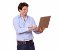 Charming young man working on laptop portrait of a while standing white background Royalty Free Stock Photography
