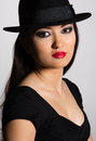 Charming young woman Asian in hat Stock Photo