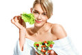 Charming young woman with lettuce leaf