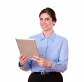 Charming young woman standing using tablet pc portrait of a in blue blouse looking at you while a on isolated white background Stock Photo