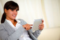 Charming young woman using her tablet pc Royalty Free Stock Images