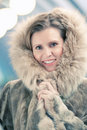 Charming young woman in a winter fur coat Royalty Free Stock Photos