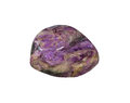 Charoite mineral specimen a massive fibrous potassium feldspar used as cabochons in jewellery and a transformation stone promoting Royalty Free Stock Image