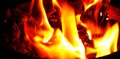 Charred paper in a container burning bright flame Stock Photo