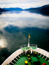 Charting new territory the bow of a large boat glides through still waters in chilean fjords Stock Photo