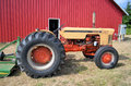 Chase tractor on a farm in front of a barn Royalty Free Stock Photo
