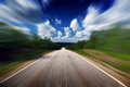 Chasing the horizon driving fast on straight road Royalty Free Stock Photography