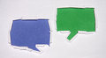 Chat signs blue and green sign these are made of torn paper Royalty Free Stock Images