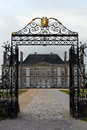 Chateau haras du pin exterior of viewed through open wrought iron gates with long driveway normandy france Royalty Free Stock Photography