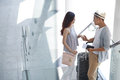 Chatting in airport smiling girl with her boyfriend before his leave Royalty Free Stock Photo