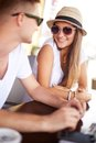 Chatting in cafe happy girl and her boyfriend sunglasses Royalty Free Stock Photos