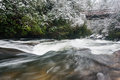 Chattooga river north carolina scenic winter snows blanket the landscape around the wild in western as it flows underneath an old Stock Image