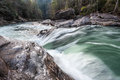 Chattooga wild and scenic river winter whitewater rapid a popular known as seven foot falls cascades over icy stones on section iv Royalty Free Stock Images