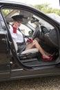 Chauffeur adjusting her seatbelt