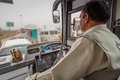 Chauffeur driving in rain bus delhi traffic an rainy morning delhi rajasthan india february Stock Image