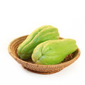 Chayote squash also known as choko in basket on white background Royalty Free Stock Photo