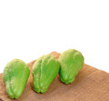 Chayote squash also known as choko in wooden bowl on white background Stock Photography