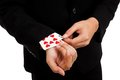 Cheating asian businessman pull playing cards from sleeve close up of Stock Photos