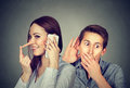 Cheating girlfriend. Man listening to a woman liar talking on mobile phone with her lover