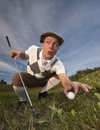 Cheating golfer Stock Images