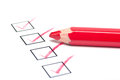 Check boxes with a red pencil series of checkmarks in black outlined on white background Stock Images