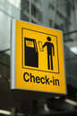 Check in sign at airport yellow the Royalty Free Stock Photo