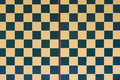Checker board a photo taken on a checkered wall design Stock Images