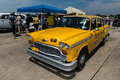 Checker Yellow Taxicab Royalty Free Stock Photo