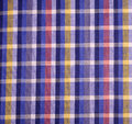 Checkered fabric pattern of blue checked with red and yellow lines Stock Images