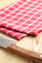 Checkered napkin and knife Royalty Free Stock Image