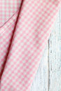 Checkered napkin on white wooden table the Stock Photography