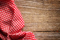 Checkered tablecloth on wood Royalty Free Stock Photo