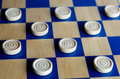 Checkers game wooden blue and white selective focus close up concept photo of business teamwork strategy and planning Royalty Free Stock Photography