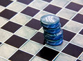 Checkers pieces game made ​​of ceramic on a game board Royalty Free Stock Images