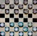 Checkers pieces game made of ceramic on a game board Stock Images