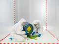 Checking a biohazard in a containment tent two laboratory technicians or scientists that has spilled from an overturned drum Stock Photos
