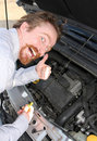Checking engine oil dipstick Royalty Free Stock Photos