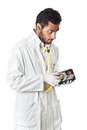 Checking hard disk a doctor technician wearing a lab coat and stethoscope holding an Stock Photography