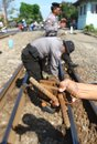 Checking railways police showing bolt which is apart from the during in solo central java indonesia Stock Photo