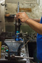 Checking shock absorber in car suspension serviceman at garage Stock Photos