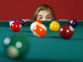 Checking for a shot while playing pool Stock Photography