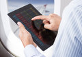 Checking stock market on tablet in airplane businessman Royalty Free Stock Photography