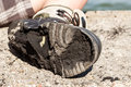 Checking on worn out shoe. Royalty Free Stock Photo