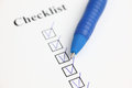 Checklist and ballpoint pen Royalty Free Stock Photo