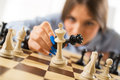 Checkmate businesswoman holding queen and king in position Royalty Free Stock Image