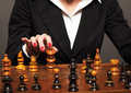 Checkmate businesswoman making her move Royalty Free Stock Photo