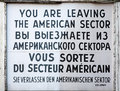 Checkpoint charlie sign at the border crossing between east and west berlin Stock Photos