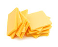 Cheddar cheese slices on white background Royalty Free Stock Photos